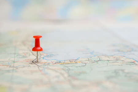 Selective focus of Red pin on map background