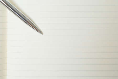 Selective focus of Pen, notebook on white background