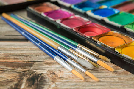 Colorful of Watercolor palette on a wooden table background Reklamní fotografie