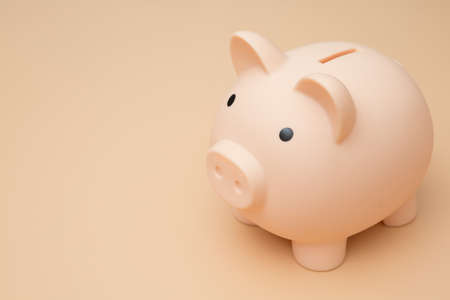 Pig piggy bank on a cream background 免版税图像