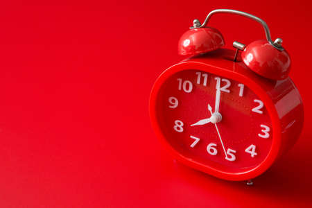 red alarm clock on a red background and copy space 免版税图像