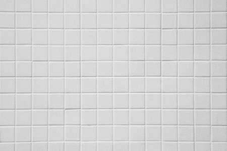 Pattern of White tiles on the wall texture background 免版税图像