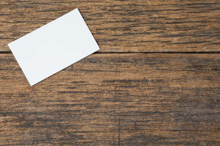 Business card on wood background and copy space 免版税图像