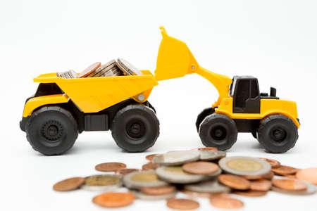 Model loader, Dump truck, coins stack on white background for money saving concept