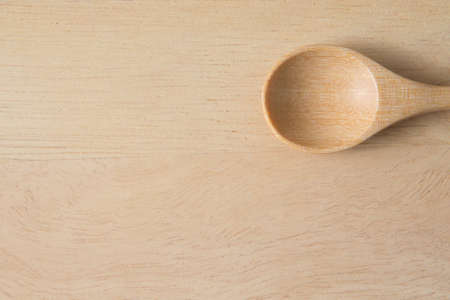 Top view of Wooden scoop on wood background and copy space 免版税图像