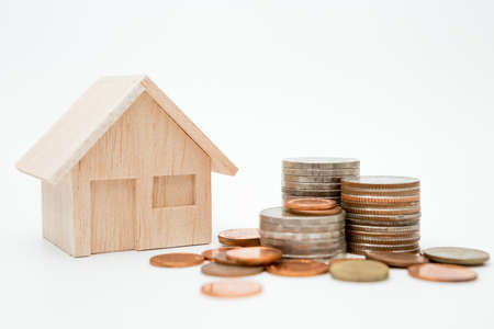 Model house, coins stack on white background for money saving concept