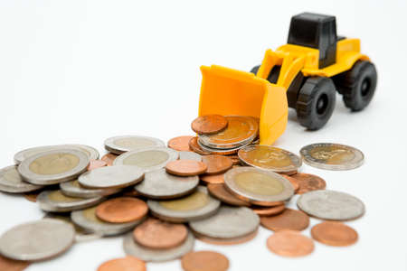 Model loader, coins stack on white background for money saving concept
