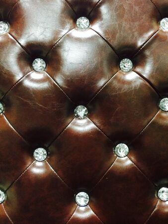 padding: Brown leather upholstery with Diamond buttons