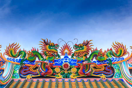 Two dragon on temple roof photo