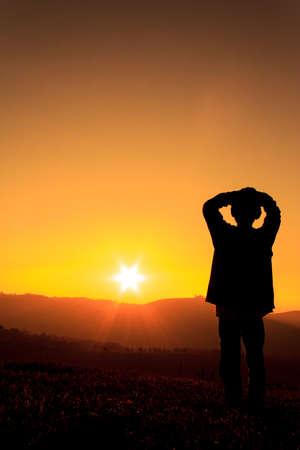 silhouette of a boy on a sunset Standard-Bild
