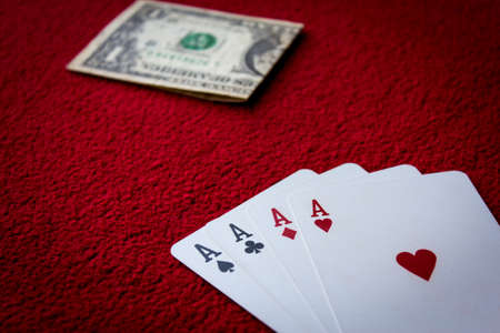Four aces  on red background