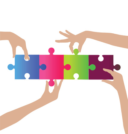 assembling: Business people assembling puzzle with teamwork concept