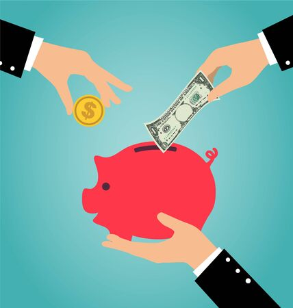 hand hold: Business hand putting coin and money into a piggy bank, Saving and investing money concept