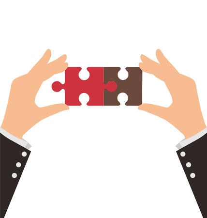 two pieces: Two Business Hands connect two pieces of puzzle, Teamwork Concept