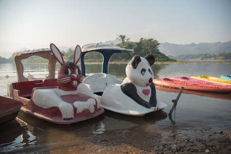 cayak: panda and rabbit shape paddle boat in river Stock Photo