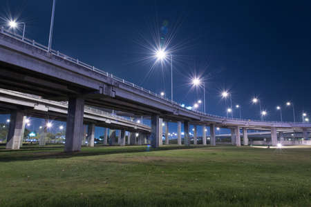 express lane: tollway express road with grass lawn in night scene