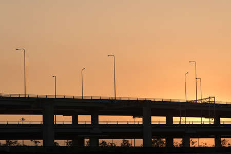 express lane: Silhouette photo of toll way in morningh sunrise