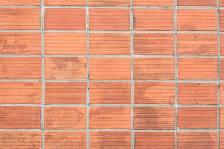 clay brick: antique orange clay brick wall texture background Stock Photo