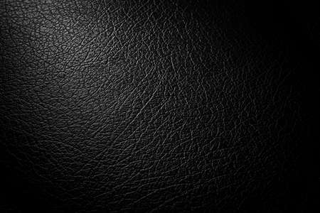 synthesis: synthesis pvc leather black condition scratched and dust  light with illuminated in studio Stock Photo