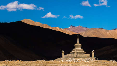 stupa with  contrast shade shadow mountain and blue sky  background in leh ladakh , india Stock Photo