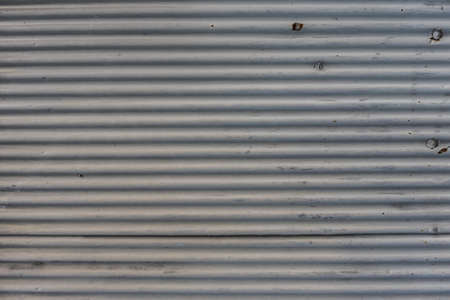 old weathered corrugated zinc texture background with rust
