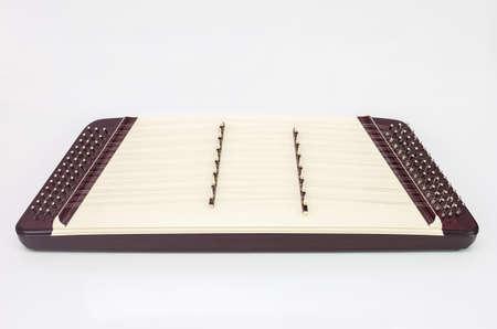 frets: Thai classical music instrument Khim 7 frets on white background