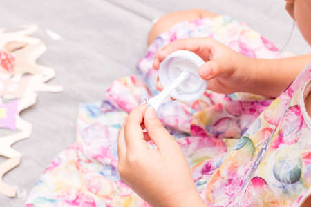 The little girl is gluing color paper. The little girl makes handcraft. Reklamní fotografie