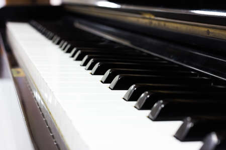 Close up piano keyboard background with selective focus