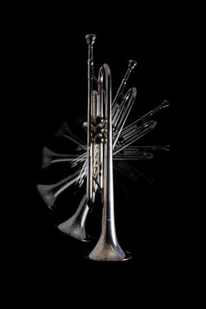 Silver trumpet isolated against a black background