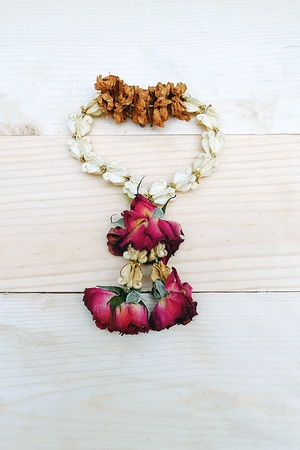 malai: Love the Dry Jasmine and Rose Flower Wreath Thai on the Table Wooden