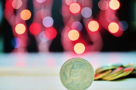 Thai coin with blurred lights dark background. Stock Photo