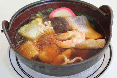 Japanese soup with vermicelli and mix of meat and vegetable photo