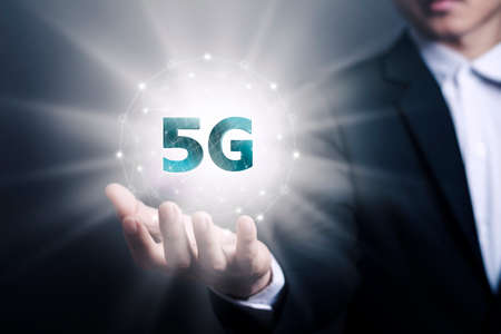 5G network, Asian male businessmen with the fastest new contract network effect in the new era, high-speed mobile Internet, new generation networks. Mixed media.