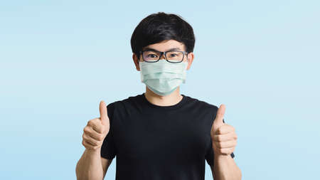 Men wear encouraging masks, cheer everyone andMedical staff, on a bright blue background, campaign wearing a mask to prevent the spread of the corona virus (covid 19) in a dire situation.