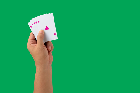 isolated playing cards in hand Stock Photo