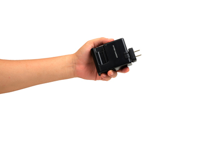 nimh: isolated hand holding charger battery