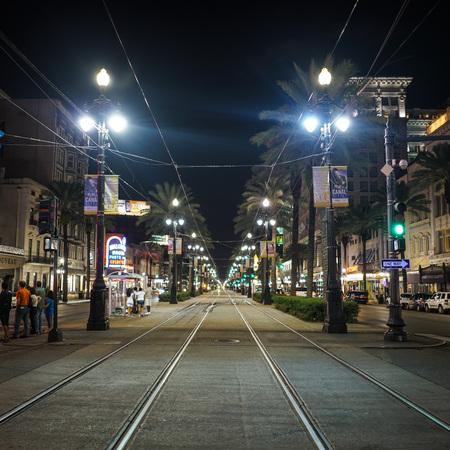 Symmetrical main street with railroad tracks Editorial