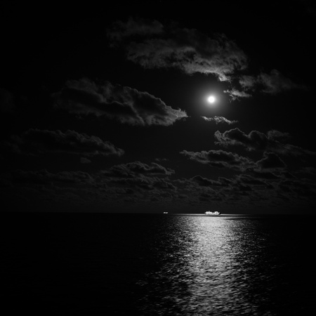Cruise ship in the moonlight at open sea