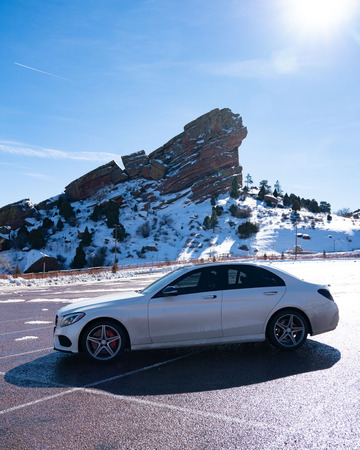 beautiful car in front of mountain with snow during winter Stockfoto