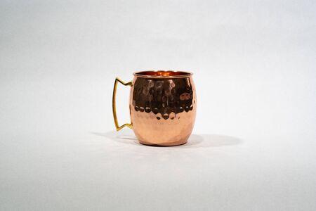 copper moscow mule mug on white background