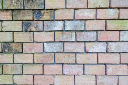 weathered: old weathered brick wall
