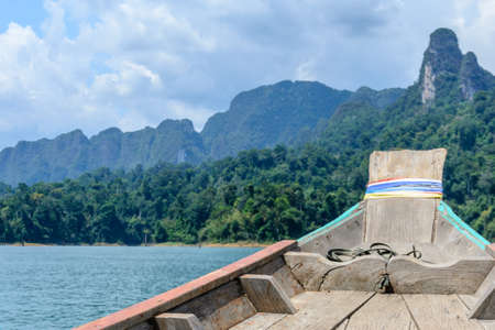 sok: boat at mountains with sky and river natural attractions in Ratchaprapha Dam at Khao Sok National Park, Surat Thani Province, Thailand Stock Photo