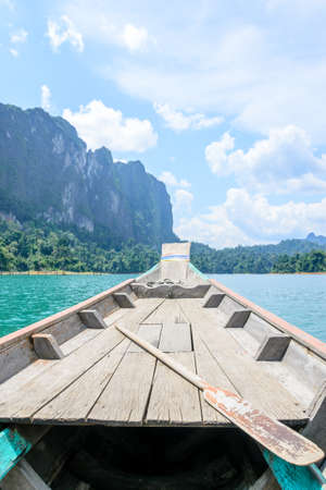 sok: boat with blue sky and river natural attractions in Ratchaprapha Dam at Khao Sok National Park, Surat Thani Province, Thailand