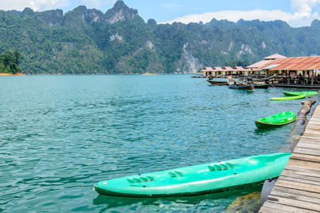 sok: canoe in a beautiful mountains lake forest and river natural attractions in Ratchaprapha Dam at Khao Sok National Park, Surat Thani Province, Thailand. Stock Photo