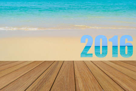teak: Happy New Year 2016 word created text from the sea picture on teak wood with beach