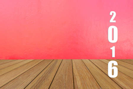 teak: Happy New Year 2016 word on teak wood with red wall texture background