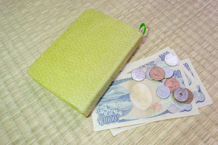 credit union: Japanese yen notes. Currency of Japan and green notebook Stock Photo