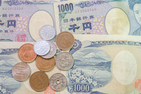 yen note: close up of japanese currency yen bank note and coin Stock Photo