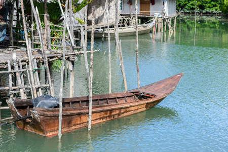 Fishing boats of fishermen moored fishing village in Thailand. 版權商用圖片