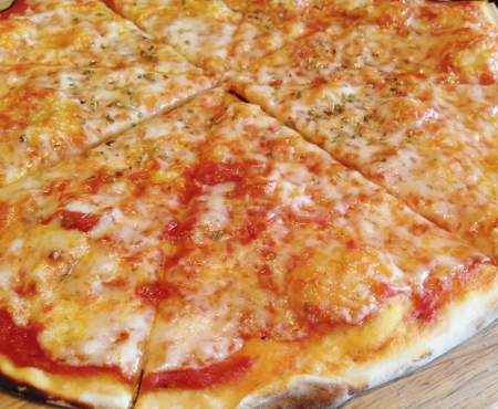Pizza Cabo Rana. Salt with cheese and tomatoes on a tray.
